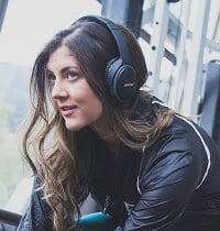 Women wearing Bose headphones