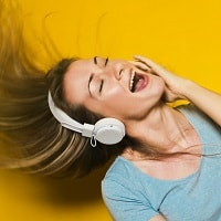 Girl-enoying-music-on-headphones