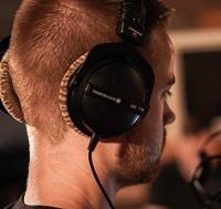 Guy wearing beyerdynamic studio headphones