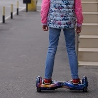 girl riding a hoverboard