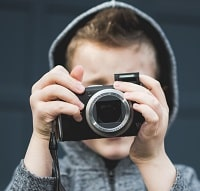kid holding the camera