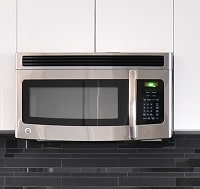 microwave isntalled in the kitchen