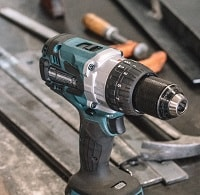 cordless drill placed in ground