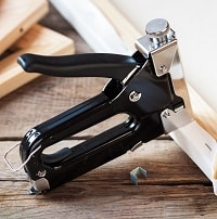 black and silver staple gun