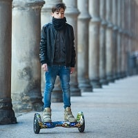boy riding a hoverboard