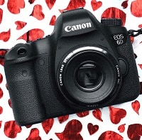 canon camera on red and white surface