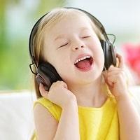 Cute girl wearing wireless headphones