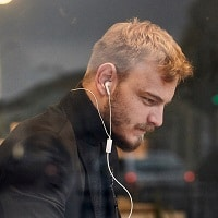man using noise canceling earbuds