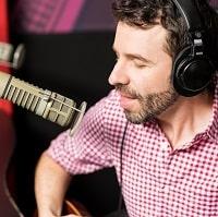 man singing with headphones on