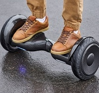 man using a black hoverboard