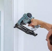 man using a nail gun