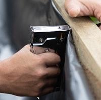 Man using staple gun