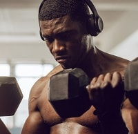 man wearing headphones during workout