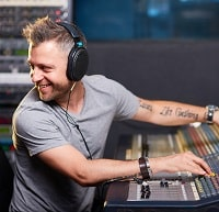professional musician mixing with headphones