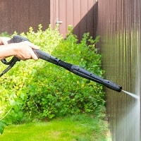 pressure washer cleaning the fences