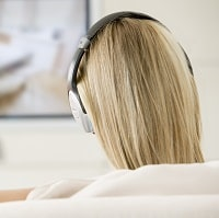 woman watching tv with headphones