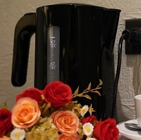 black electric kettle with flowers