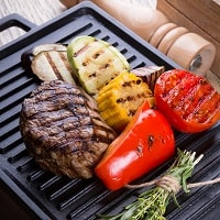 Electric grill with meat and veggies