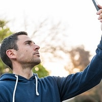 man-searching-for-cell-phone-signals
