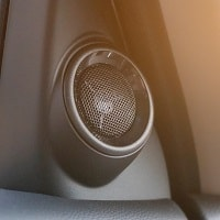 Black car speaker mounted inside the car