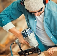 Carpenter using a nail gun