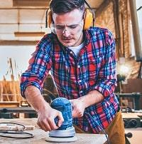 Carpenter at Work Polishing Wood