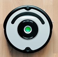 Silver and black robot vacuum