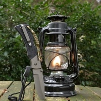 Kerosene lamp, knife and fire striker waiting for survival adventure.