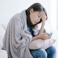 woman get sick and fever